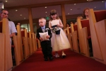 The little ones walking down the aisle first.