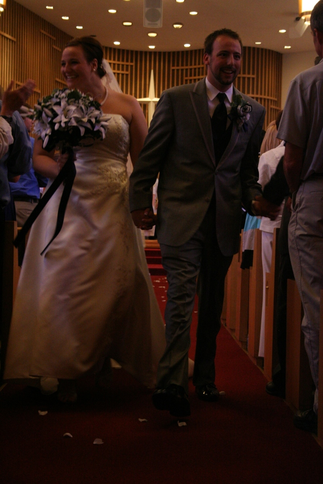 Walking down the aisle as husband and wife.