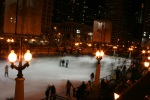 A picture of blurred skaters at the Millenium Park ice rink.