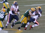 A few Packers bring Jay Cutler to the ground.