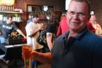 A Scotty's Brewhouse VIP shows off his beer.