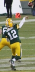 Aaron Rodgers sails a ball down the field at Lambeau against the Oakland Raiders.